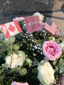 Flowers next to the grave site. Notice JASNA representing.